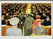 NORTH KOREAN SOLDIERS TAKING JANG SONG THAEK from ruling workers' party meeting