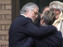 Dave Lee Travis and his wife outside the court