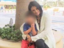 Afsana Lachaux posing with her son