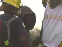 A miner is rescued from an abandoned gold mine shaft near Benoni, Johannesburg.