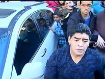 Diego Maradona has been filmed slapping a journalist who allegedly winked at his ex-partner.