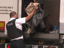 Police stop a lorry containing 20 dehydrated 'stowaways'