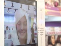 Magic Mirror allowing users to try out different hairstyles