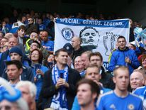 Chelsea fans show their support for former manager Jose Mourinho during the Barclays Premier League match between Chelsea and Everton at Stamford Bridge
