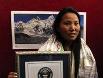 Chhurim Sherpa Displays Her Certificate