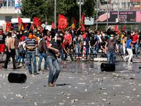Demonstrators clash with police during a protest against Turkey's PM Erdogan and his ruling AKP in central Ankara