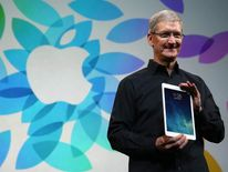 Apple CEO Tim Cook holds the new iPad Air
