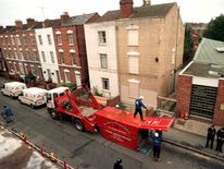 "Workmen unload equipment outside 25 Cromwell Street in Gloucester October 6. Britain's ""House of Hor.."
