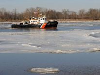 The Coast Guard Cutter Capstan breaks ice on the Delaware River in New Jersey