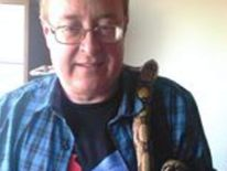 Dale Bolinger seen here in his facebook profile picture with a pet snake around his neck