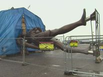 Damien Hirst's statue Verity being put into position