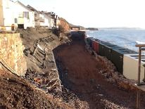 Damaged rail track at Dawlish