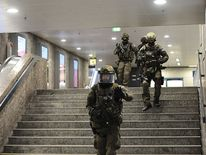 Police walk inside a subway station