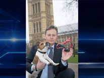 Matthew Offord, Conservative MP with a Jack Russell and electric dog collar