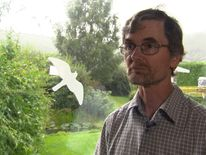 Dr Clive Mowforth, who does not want cats killing birds in his garden