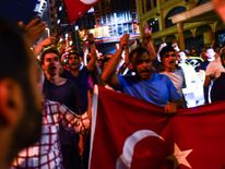Supporters of Turkish President Recep Tayyip Erdogan march in the main streets of Istanbul