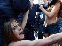Femen protest near Tunisia Embassy in Paris