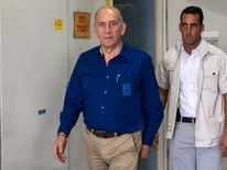 Former Israeli Prime Minister Ehud Olmert leaves Tel Aviv District Court