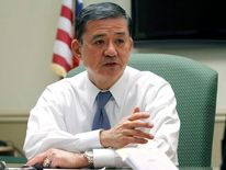 US Veterans Affairs Secretary, retired general Eric Shinseki talks with veterans during a visit to the Coatesville VA Medical center in Coatesville