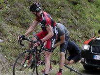 BMC Racing Team rider Cadel Evans suffers a puncture