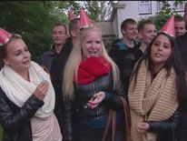 Partygoers wear hats at gathering organised on Facebook in Haren, Netherlands