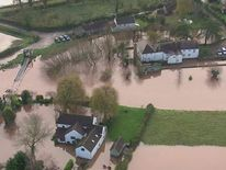 Homes surrounded by flood water in Devon