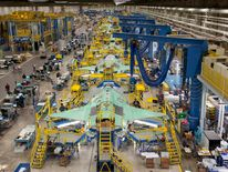Workers on the moving line and forward fuselage assembly areas for the F-35 JSF at Lockheed Martin Corp's factory located in Fort Worth, Texas