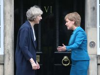 Prime Minister Theresa May (left) is greeted by Scotland's First Minister Nicola Sturgeon
