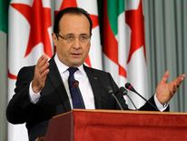 France's President Francois Hollande gives a speech at the Palais des Nations in Algiers on the second day of a two-day official visit