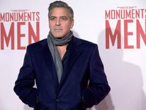 George Clooney poses on the red carpet as he arrives for the UK premiere of the film 'The Monuments Men' in central London in February
