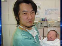 Kazuhiro Kawamura with baby. Photo courtesy of Kazuhiro Kawamura