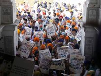 Sikhs hold placards during the 26th anniversary of operation Blue Star in Amritsar