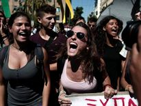 High-school students shout slogans during an anti-government rally in Athens