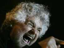 Italian showman Beppe Grillo waves to su