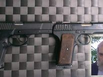 Imitation handguns found on Miles Alura, pictured inset in his disguise
