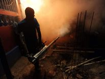 Haiti health staff spray to exterminate mosquitoes in Port-au-Prince