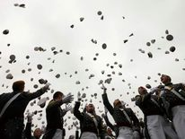 Graduates toss their hats in the air at the end of a commencement ceremony at the United States Military Academy at West Point