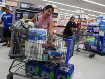 Woman buys hurricane supplies in Mililani