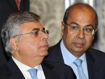 Indian industrialist brothers Ashok Hinduja (L) and Prakash Hinduja