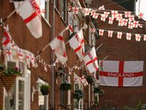 England national flags and banners cover houses on Wales Street in Oldham