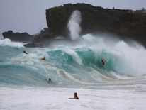 Bodysurfers off Oahu, Hawaii