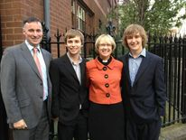 Reverend Dr Heather Morris with her husband and two sons