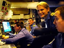Commander Sarah West in operations room of ship
