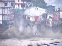 Building collapses in flash flooding in Uttarakhand, India