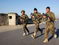 Afghan National Army soldiers arrive at the site of an attack in Jalalabad