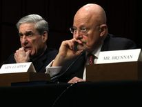 Director of National Intelligence James Clapper (R) and FBI Director Robert Mueller (L)