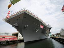 Japan Maritime Self-Defense Force'S new helicopter destroyer Izumo is seen before its launching ceremony in Yokohama