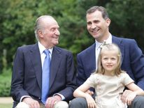Spain's King Juan Carlos, Crown Prince Felipe and Infanta Leonor pose at Zarzuela Palace in Madrid