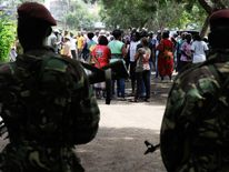 Kenyan paramilitaries stand guard at a polling station