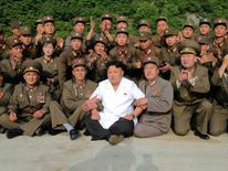 North Korean leader Kim Jong Un poses with soldiers in this undated photo released by North Korea's Korean Central News Agency (KCNA) in Pyongyang